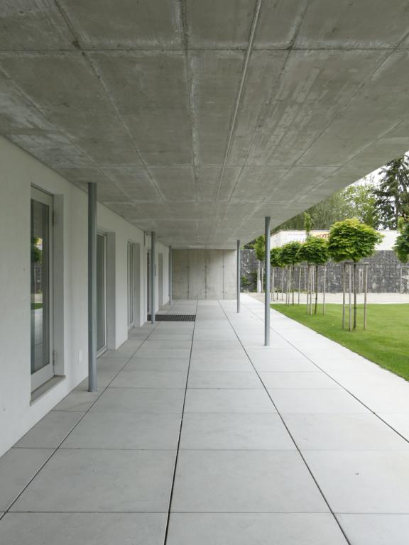 Large Concrete Terrace Connecting New Amenities For The Residents In Ground  Floor And The Backyard. © Jakub Skokan, Martin Tůma